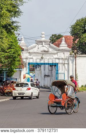 Solo, Indonesia - November, 02, 2017 Entrance Gate Of The Colorful Blue Palace Of The Sultan In Sura