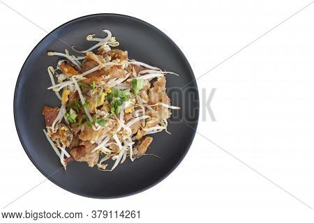 Top View Of Crisp Fried Mussel Pancakes Or Mussel Omelette In Black Plate Isolated On White Backgrou