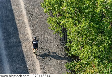 Montreal, Ca - 31 July 2020: Aerial View Of Man Riding Bike On St Lawrence Seaway Bike Path