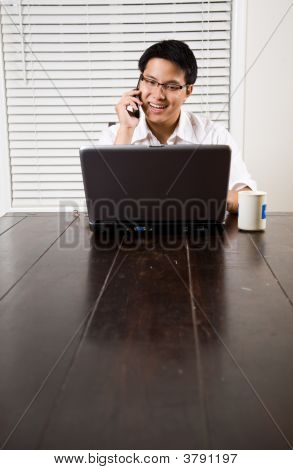 Asian Entrepreneur On The Phone