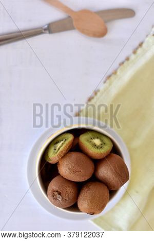 Delicious Ripe Kiwi Fruits In A Bowl. Healthy Eating Or Healthy Lifestyle, Green Juicy Kiwi/ Concept