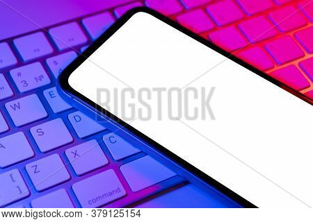Smartphone In Blue And Pink Lights With Blank Screen Mock Up. Phone Isolated Screen. Mobile Phone Wh