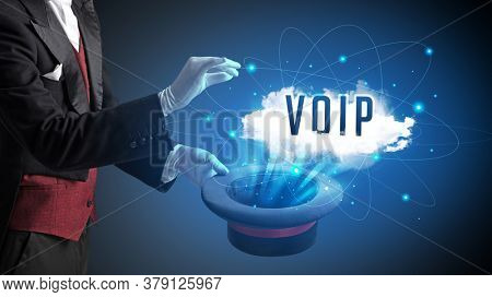 Magician is showing magic trick with VOIP abbreviation, modern tech concept