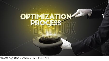 Illusionist is showing magic trick with OPTIMIZATION PROCESS inscription, new business model concept