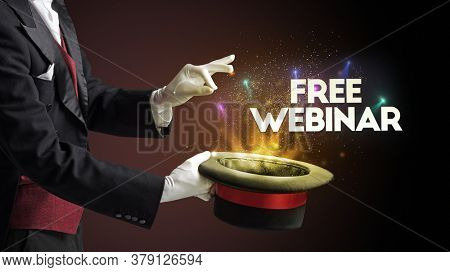 Illusionist is showing magic trick with FREE WEBINAR inscription, new business model concept