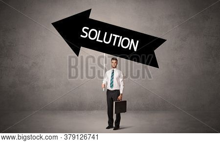 Young business person in casual holding road sign with SOLUTION inscription, business direction concept