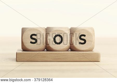 Sos Concept. Wooden Block With Text On Table. Copy Space