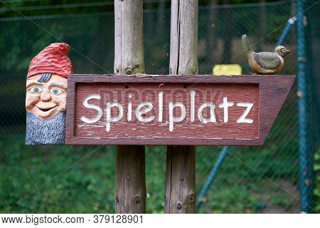 Signpost To A Playground With The Inscription Spielplatz Along A Hiking Trail In Germany