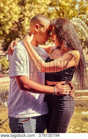 Loving Young Couple At The Park With A Fountain 3