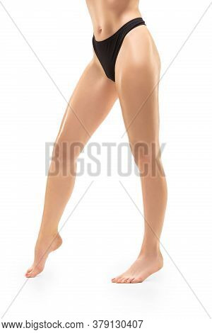 Sportive. Beautiful Female Legs And Belly Isolated On White Background. Beauty, Cosmetics, Spa, Depi