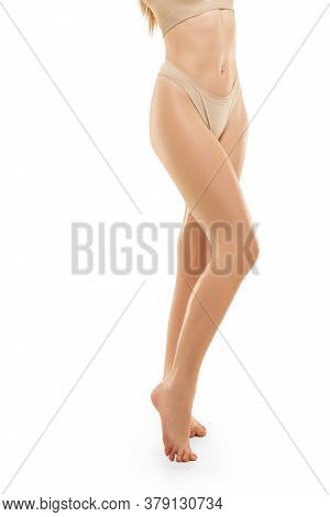 Beauty. Beautiful Female Legs And Buttlocks Isolated On White Background. Beauty, Cosmetics, Spa, De