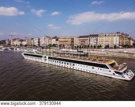 River Cruise Boats On Danube River In Budapest - April, 2019 Row Of Cruise Ships On Shore And On Riv