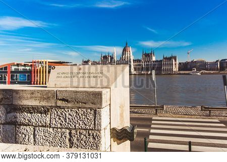 Budapest, Hungary - January, 2019: Textured Carved Stone Retaining Wall With Water Level Marker In B