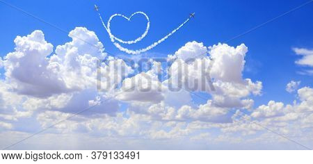 Two aircrafts draw a heart in the sky. Flight route of aircraft in shape of a heart. Love concept for traveling the world