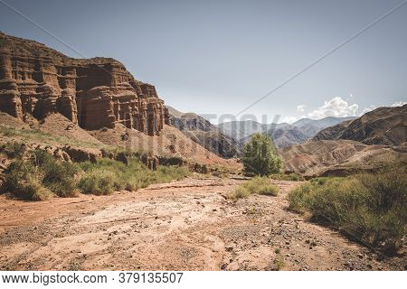 Fantastic Clay Red Castles In The Sandy Desert Of The  Canyon Konorchek, In Kyrgyzstan