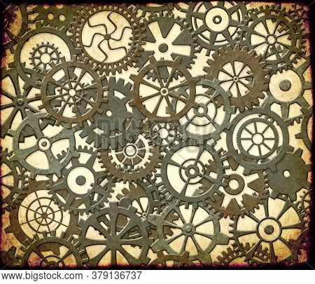 Grunge background with paper texture and metallic frame with vintage machine gears and cogwheel. Can be used for steampunk and mechanical design