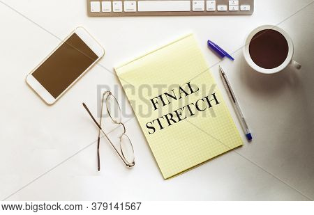 Final Stretch Text On The Yellow Paper With Phone, Coffee, Pen