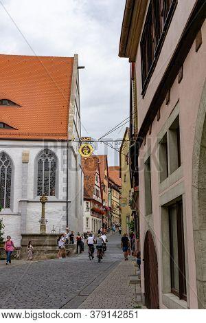 Rothenburg Ob Der Tauber, Bavaria / Germany - 23 July 2020: Tourists Enjoy A Visit To Historic Rothe