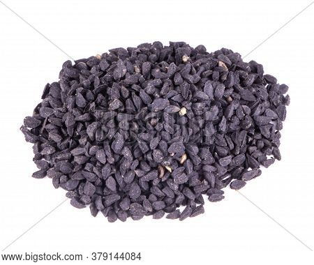 Black Cumin, Stacked In A Pile And Isolated On White Background