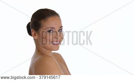 Beautiful cheerful young spa woman over white background.