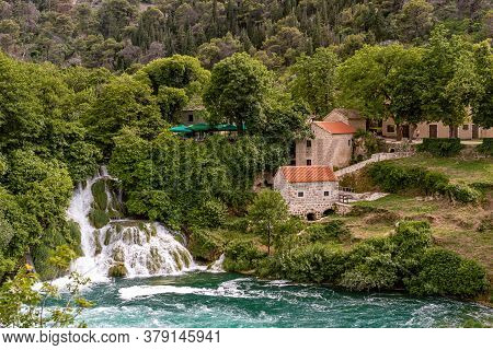 The Waterfalls Of Krka National Park And Stone Mill Building With Orange Tile Roof, Dalmatia, Croati