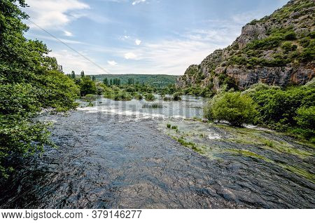 Rapids In The Krka River Above The Roski Slap Waterfalls In Dalmatia, Croatia