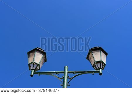 Old-style Lantern On The Blue Sky Background. Europe In The Sky Of Portugal Lantern And Abstract Ill
