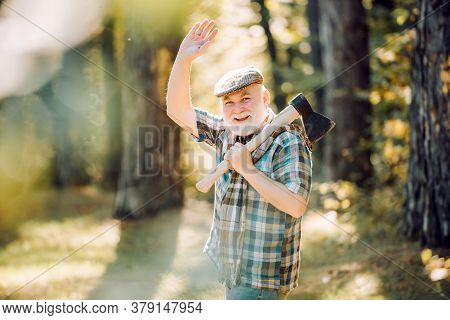 Smiling Man With Axe. Rest In Forest. Outdoor Portrait. Old Bearded Male. Elderly Male Walk In Fores