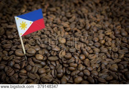 Philippines Flag Sticking In Roasted Coffee Beans. The Concept Of Export And Import Of Coffee