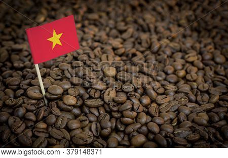 Vietnam Flag Sticking In Roasted Coffee Beans. The Concept Of Export And Import Of Coffee