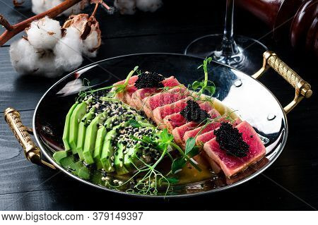 Mexican Tuna Steak With Avocado Closeup On A Plate. Red Steak Tuna Grilled Bbq With Avocado
