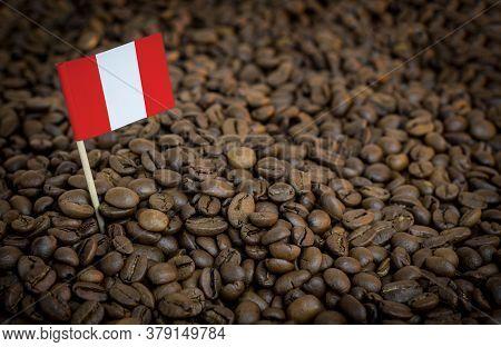 Peru Flag Sticking In Roasted Coffee Beans. The Concept Of Export And Import Of Coffee