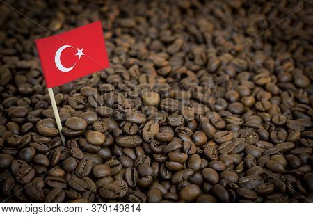 Turkey Flag Sticking In Roasted Coffee Beans. The Concept Of Export And Import Of Coffee