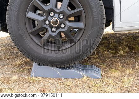 Oberbrombach, Rp / Germany - 26 July 2020: Close Up Of An Rv Leveler Under A Campervan Wheel