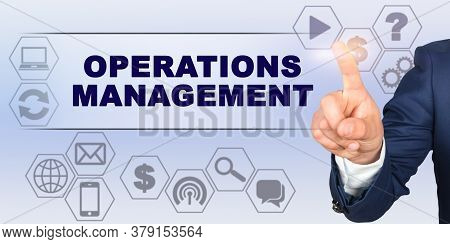 Business Concept. Businessman Touching Virtual Screen With His Finger. Screen Caption - Operations M