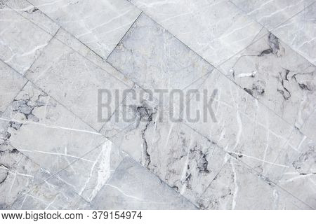Diagonal Staggered Design Of White Carrara Marble Flooring Tiles Used As Kitchen Countertop Backspla