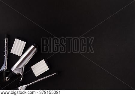 Frame Of Professional Hair Dresser Tools On Black Background