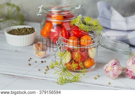 Homemade Canning. Ingredient For Pickles Tomatoes With Dill On The Kitchen Table In A Rustic Style.