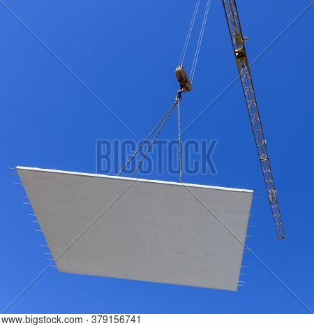Waterproof Concrete Wall On A Hook Of A Crane At The Construction Site