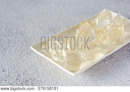 Gelatin, Agar-agar, Gelatinous Mass (cubes In The Form Of Crystals) On A Gray Background. Gelling Ag