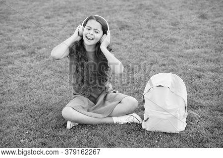 Girl Headphones Listening Music. Pleasant Time. Child Headphones Listen Music. Modern Technology. Sc