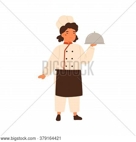 Adorable Children Little Chef Cute Girl In Professional Uniform. Child In Cooking Apron. Smiling Kid