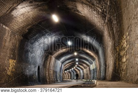 Interior Of Headstone Tunnel On The Monsal Trail, With Man Walking In Bakewell.