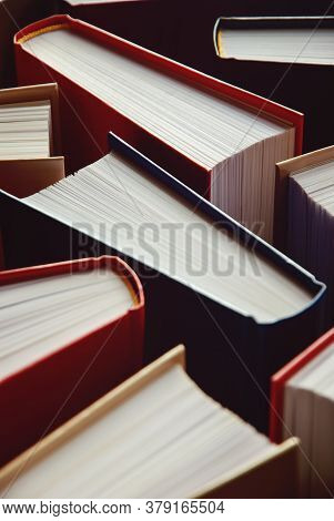 Many Hardcover Books Standing As Background, Vertical Photograph
