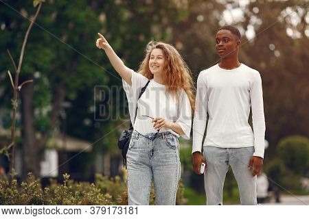 Interracial Students Has A Fun And Laughs Cheerfully In Park