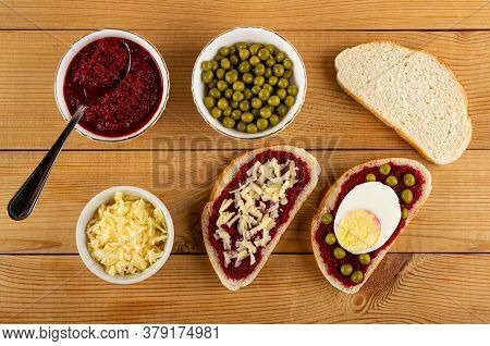 Teaspoon In Glass Bowl With Beetroot Caviar, Bowl With Green Peas, Bowl With Grated Cheese, Sandwich