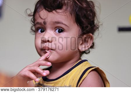Close Up Of A Beautiful Indian Child Eats Semia, Child Portrait, Indoors Child , Child Eating Health
