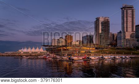 Vancouver, British Columbia/canada - July 11, 2019: Sunset Over The High Rise Buildings, Float Plane