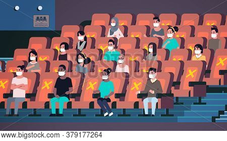 People In Protective Masks Watching Movie Keeping Distance To Prevent Coronavirus Social Distancing
