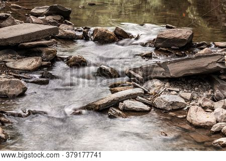 Beautiful Creek In Robert H. Treman State Park, Ithaca, Ny. Long Exposure Of A Stony Creek